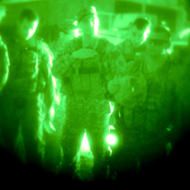 group of soldiers seen through night vision goggles