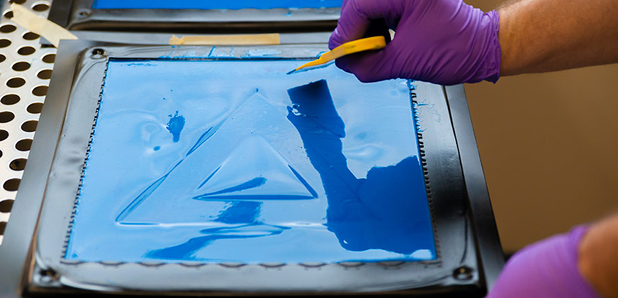 Image of blue liquid compound setting in a molded tray.