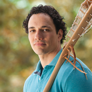 Image of Laurier alumnus Allan Downey holding a lacrosse stick