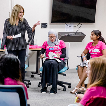 career consultant presents to young girls about business leadership